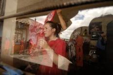 PILLARO, Tunguragua (05-01-2010).- Gisela Alvarez, de 17 a–os, se viste de Pareja de l'nea con la ayuda de su madre Betty Alvarez, en la comunidad de Tunguipamba, para participar en la tradicional diablada de Pillaro, en el Cant—n P'llaro, en la provincia de Tungurahua.